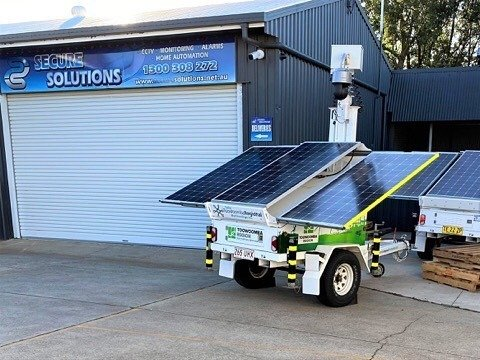 Rapid Deploy Solar Trailer in front of shed