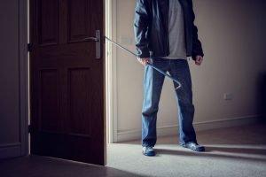 burglar entering a house